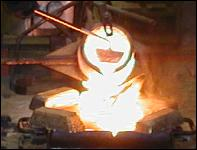 pouring bronze from a crucible on the bronze casting workshops and art breaks at the john mckenna sculpture studio in ayrshire scotland