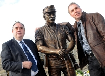 First Scottish minister Alex Salmond MSP unveiling the Auchengeich Miner statue and the sculptor John McKenna from Turnberry, Ayrshire