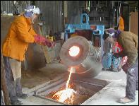 pouring bronze from a tilting furnace on the bronze casting workshops and art breaks at the john mckenna sculpture studio in ayrshire scotland